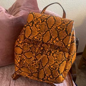 Orange snakeskin backpack